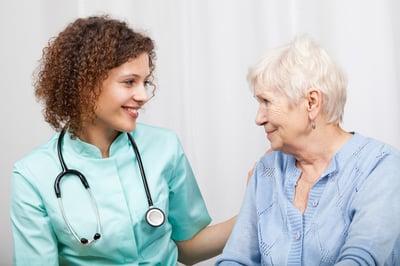 Smiling nurse and happy elderly lady, horizontal
